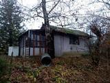 Eladó zártkerti telek kis házzal Igalban!