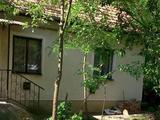 Pocsaj mellett, Kismarjai, 84 m2-es ház, vágásérett erdővel, 3311 m2-es telken eladó.