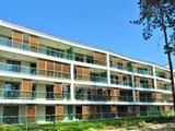 Újépítésű lakás saját vízparttal